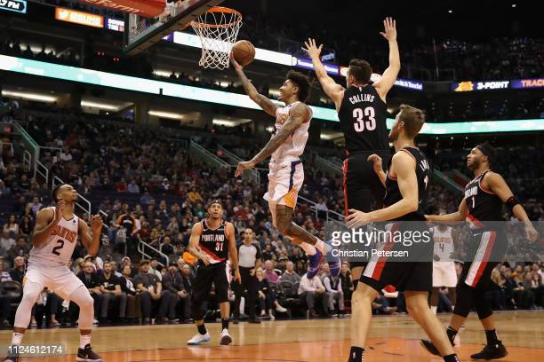 Kelly Oubre Jr #3 of the Phoenix Suns laysup a shot past Zach Collins of the Portland Trail Blazers during the first half of the NBA game at Talking...