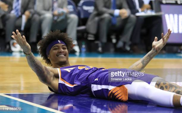 Kelly Oubre Jr. #3 of the Phoenix Suns reacts after a play against the Charlotte Hornets during their game at Spectrum Center on December 02, 2019 in...