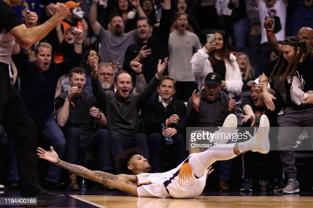 Kelly Oubre Jr #3 of the Phoenix Suns reacts after hitting a three point shot and drawing a foul against the Portland Trail Blazers during the second...
