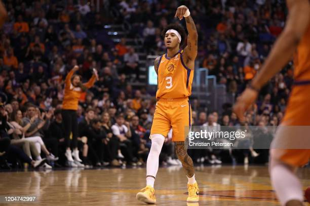 Kelly Oubre Jr #3 of the Phoenix Suns reacts to a three point shot against the Houston Rockets during the second half of the NBA game at Talking...