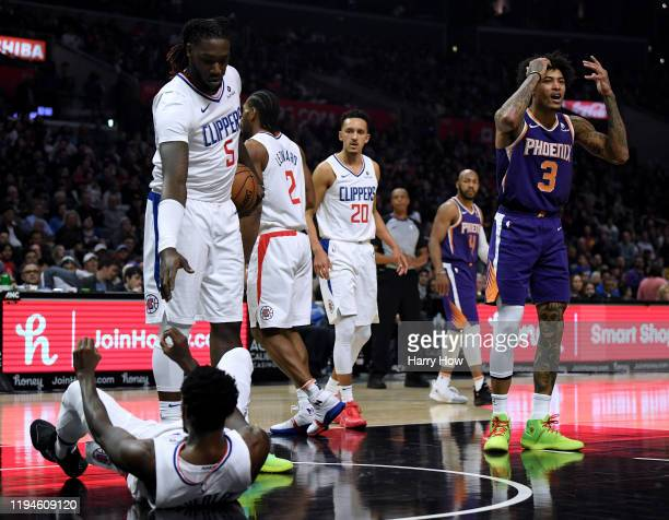 Kelly Oubre Jr #3 of the Phoenix Suns reacts to his foul his third of the game on Patrick Beverley of the LA Clippers as he is helped up by Montrezl...