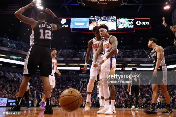 Kelly Oubre Jr #3 of the Phoenix Suns reacts with Deandre Ayton after scoring and drawing a foul from the San Antonio Spurs during the second half of...
