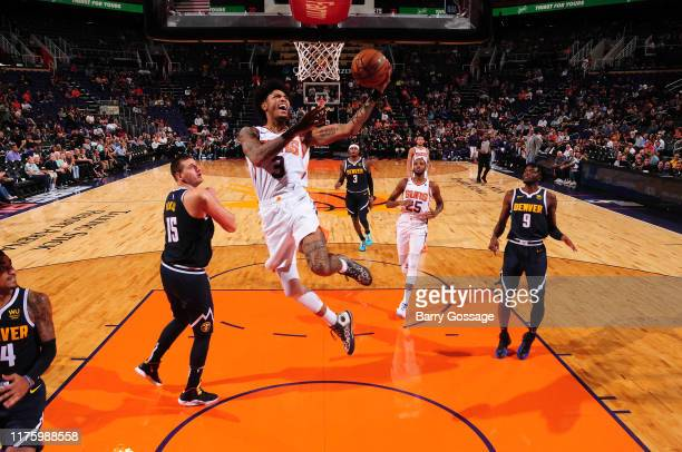 Kelly Oubre Jr #3 of the Phoenix Suns shoots the ball against the Denver Nuggets during a preseason game on October 14 2019 at Talking Stick Resort...