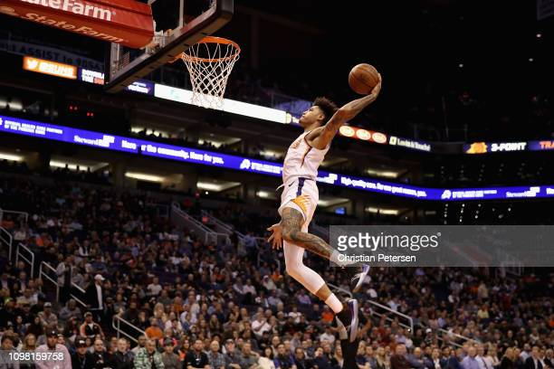 Kelly Oubre Jr #3 of the Phoenix Suns slam dunks against the Minnesota Timberwolves during the second half of the NBA game at Talking Stick Resort...