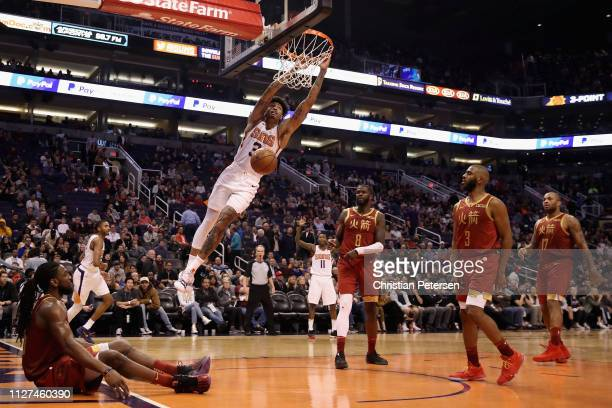 Kelly Oubre Jr #3 of the Phoenix Suns slam dunks the ball against the Houston Rockets during the second half of the NBA game at Talking Stick Resort...