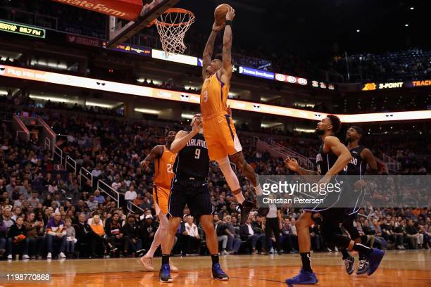 Kelly Oubre Jr #3 of the Phoenix Suns slam dunks the ball over Nikola Vucevic of the Orlando Magic during the second half of the NBA game at Talking...