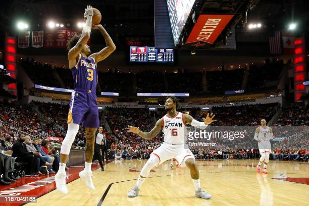 Kelly Oubre Jr #3 of the Phoenix Suns takes a three point shot defended by Ben McLemore of the Houston Rockets in the first half at Toyota Center on...