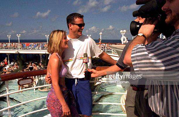 Kelly Packard and her husband Darrin Privett are interviewed by a TV crew aboard the Grand Princess on her Valentine's cruise to the Caribbean