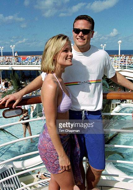 Kelly Packard Baywatch star shares a warm moment with husband Darrin Privett aboard the Love Boat Grand Princess where the two were enjoying a...