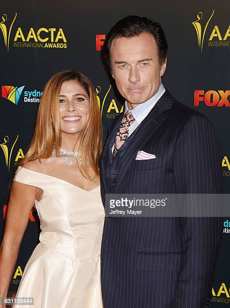 Kelly Paniagua and actor Julian McMahon arrive at the 6th AACTA International Awards at Avalon Hollywood on January 6 2017 in Los Angeles California