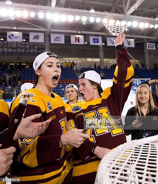 Kelly Pannek of the Minnesota Golden Gophers celebrates by cutting the goal netting with teammate Milica McMillen after winning the 2016 NCAA...