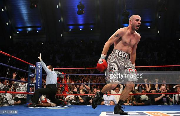 Kelly Pavlik celebrates his victory over Jermain Taylor as the referee calls off the bout during their WBC WBO World Middleweight Championship fight...