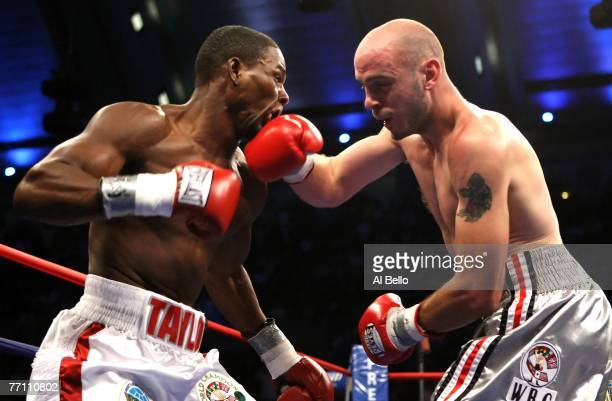 Kelly Pavlik lands a right hook against Jermain Taylor during their WBC WBO World Middleweight Championship fight at Boardwalk Hall on September 29...