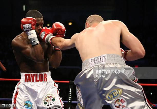Kelly Pavlik lands a straight left against Jermain Taylor during their WBC WBO World Middleweight Championship fight at Boardwalk Hall on September...