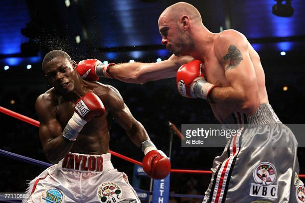 Kelly Pavlik lands a straight right against Jermain Taylor during their WBC WBO World Middleweight Championship fight at Boardwalk Hall on September...