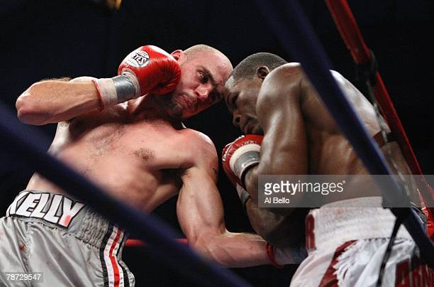 Kelly Pavlik throws a jab to the body during his WBC WBO World Middleweight Championship fight against Jermaine Taylor at Boardwalk Hall on September...