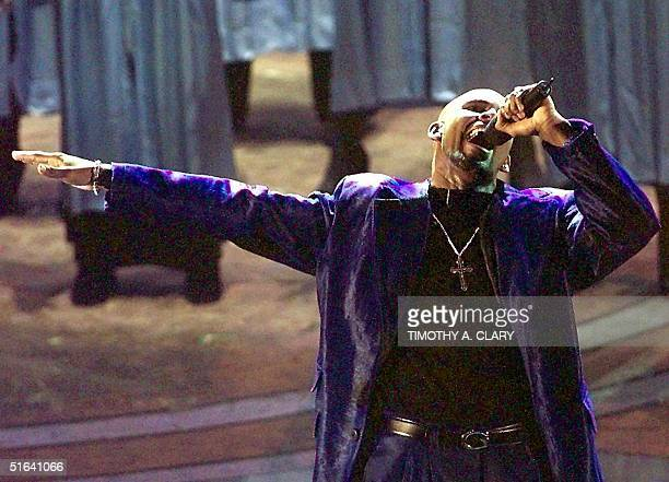 R Kelly performs his song 'I Believe I Can Fly' during the 40th Grammy Awards at Radio City Music Hall in NEw York 25 February Kelly won the Grammy...