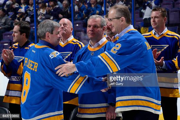 Kelly Plager son of Barclay Plager greets Al MacInnis during Bob Plager's number retirement ceremony prior to a game between the Toronto Maple Leafs...