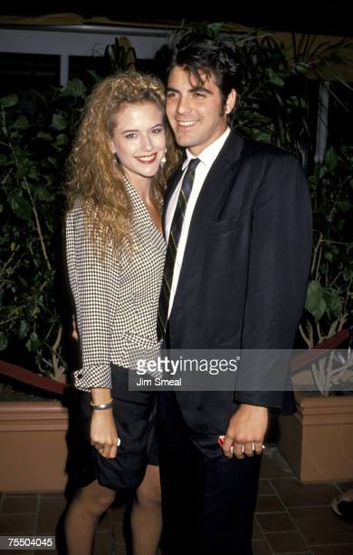 Kelly Preston and George Clooney at the AMC Century 14 Theater in Los Angeles California
