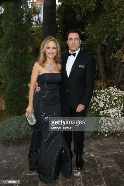 Kelly Preston and John Travolta attend the Puerto Azul Experience Inside Party at the 67th Annual Cannes Film Festival on May 21 2014 in Cannes France
