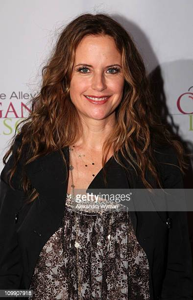 Kelly Preston arrives at Kirstie Alley's Organic Liaison Store Grand Opening on March 9 2011 in Los Angeles California