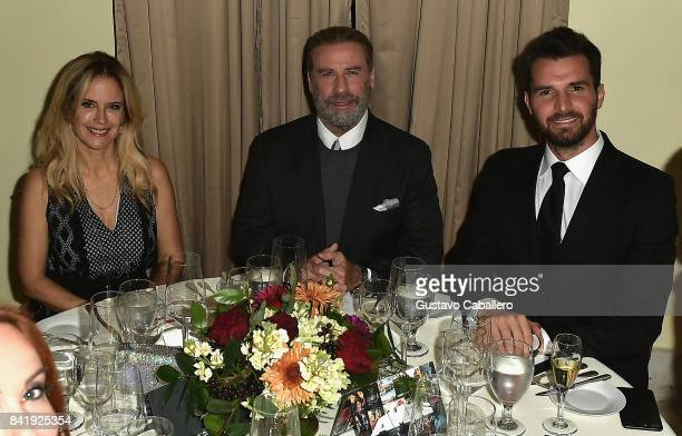 Kelly Preston John Travolta and Andrea Iervolino attend the Ambi Gala In Honor of the Movie 'Trading Paint' on September 1 2017 at an unspecified...