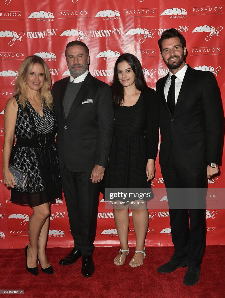 Kelly Preston,John Travolta,Ella Bleu Travolta and Andrea Iervolino attend the Ambi Gala In Honor of the Movie 'Trading Paint' on September 1, 2017 at an unspecified location in the United States.