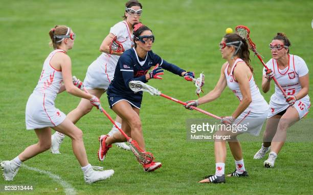 Kelly Rabil of the United States breaks through the defence of Poland during the Lacrosse Women's match between USA and Poland of The World Games at...