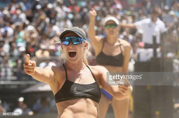 Kelly Reeves and Brittany Howard celebrate winning a point during their semifinal match against Emily Day and Betsi Flint at the AVP San Francisco...