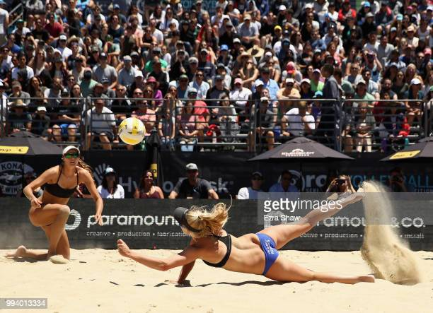 Kelly Reeves dives for the ball as her partner Brittany Howard looks on during their semifinal match against Emily Day and Betsi Flint at the AVP San...