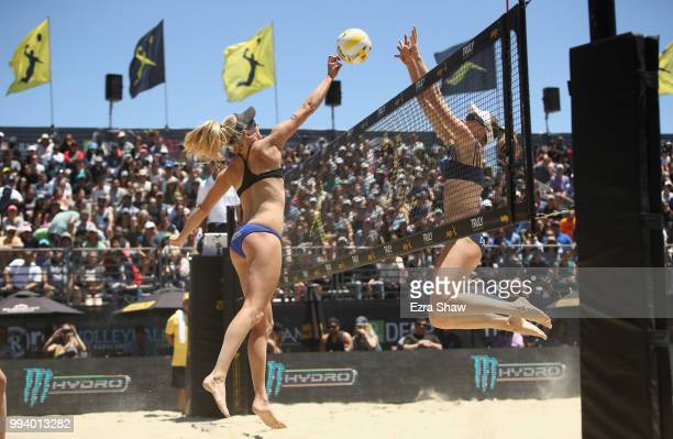 Kelly Reeves tries to hit the ball around Emily Day during their semifinal match at the AVP San Francisco Open at Pier 3032 on July 8 2018 in San...