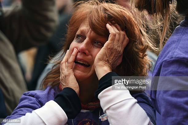 Kelly Riley cries as she listens to the song 'How to Save a Life' by The Fray a song that her son Richie Rodier liked as she and others gather for...