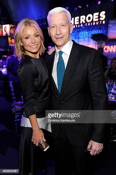 Kelly Ripa and Anderson Cooper attend 2013 CNN Heroes An All Star Tribute at The American Museum of Natural History on November 19 2013 in New York...