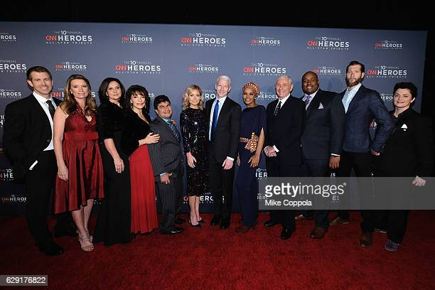 Kelly Ripa and Anderson Cooper pose with 2016 CNN Heroes Brad Ludden Becca Stevens Georgie Smith Sherri Franklin Jeison Aristizabal Umra Omar Harry...