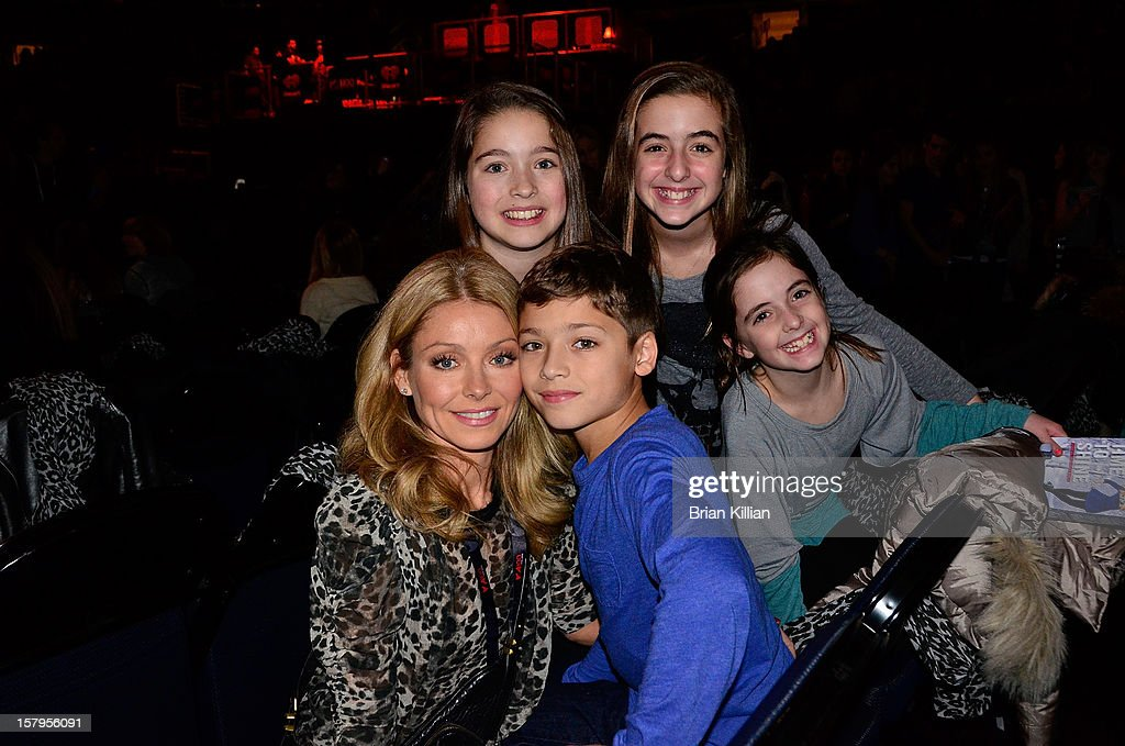 Kelly Ripa and family during Z100's Jingle Ball 2012 presented by Aeropostale at Madison Square Garden on December 7, 2012 in New York City.