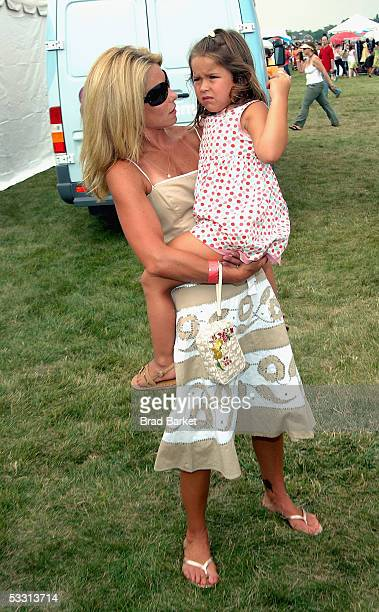 Kelly Ripa and Lola Grace Consuelos arrive at the InStyle Magazine and Donna Karan Present Super Saturday event July 30 2005 in East Hampton New York