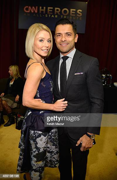 Kelly Ripa and Mark Consuelos pose backstage during the 2014 CNN Heroes An All Star Tribute at American Museum of Natural History on November 18 2014...