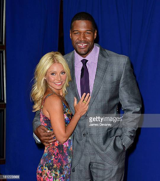Kelly Ripa and Michael Strahan pose outside Live with Kelly and Michael at ABC Lincoln Center Studios on September 4 2012 in New York City