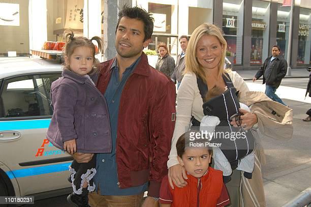 Kelly Ripa husband Mark Consuelos children Michael Lola Joaquin in kelly's arms