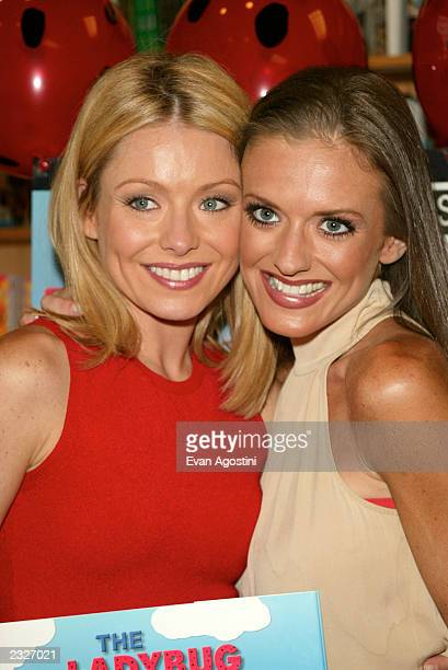 Kelly Ripa joins her sister at a booksigning for Linda Ripa's childrens book The Ladybug Blues at Borders Bookstore in New York City July 24 2002...