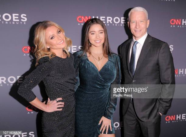 Kelly Ripa Lola Grace Consuelos and Anderson Cooper attend the 12th Annual CNN Heroes An AllStar Tribute at American Museum of Natural History