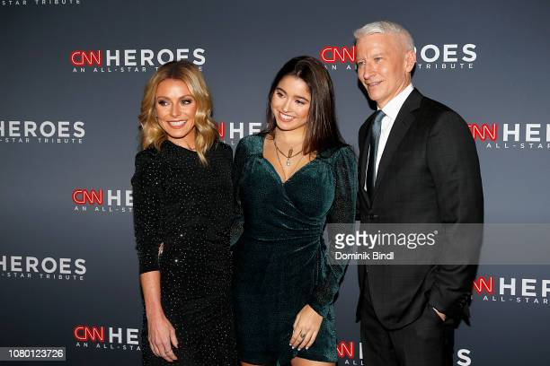 Kelly Ripa Lola Grace Consuelos and Anderson Cooper attend the 12th Annual CNN Heroes An AllStar Tribute at American Museum of Natural History on...
