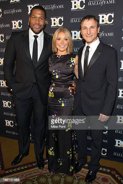 Kelly Ripa Michael Strahan and Producer Michael Gelman attends the Broadcasting and Cable 23rd Annual Hall of Fame Awards Dinner at The Waldorf...