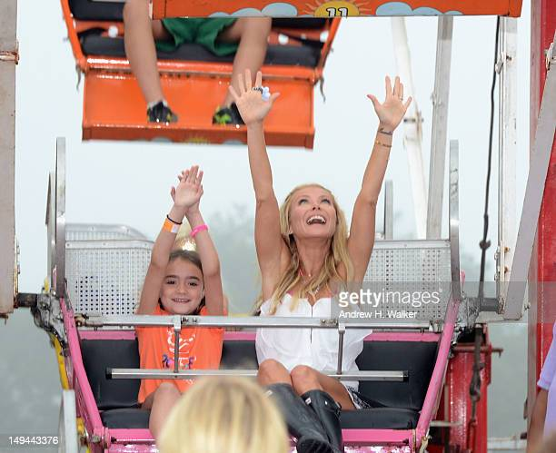 Kelly Ripa rides the Ferris Wheel during OCRF's 15th Annual Super Saturday hosted by Kelly Ripa COVERGIRL Paula Patton Donna Karan and InStyle at...