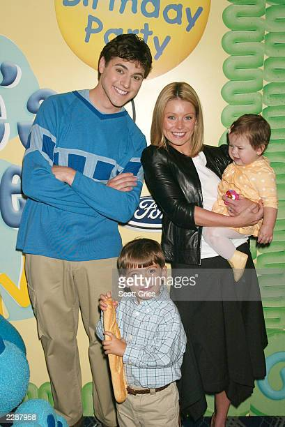 Kelly Ripa with her daugther Lola Grace and her son Michael Joseph and from Blue's Clues Donovan Patton as Joe at a party celebrating the opening...