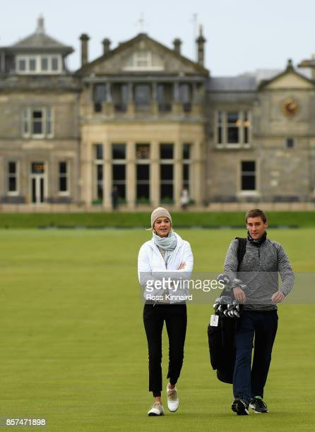 Kelly Rohrbach Actress and her caddie walk down the 1st fairway during practice prior to the 2017 Alfred Dunhill Links Championship at The Old Course...