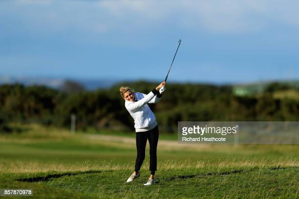 Kelly Rohrbach Actress plays her second shot on the 17th during day one of the 2017 Alfred Dunhill Championship at The Old Course on October 5 2017...