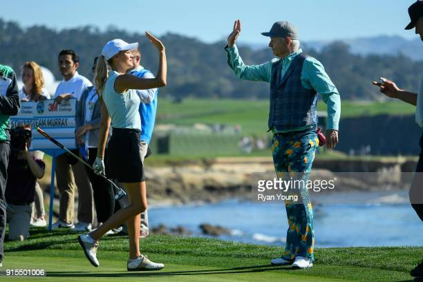 Kelly Rohrbach and Bill Murray high five during the 3M Celebrity Challenge during practice of the ATT Pebble Beach ProAm at Pebble Beach Golf Links...