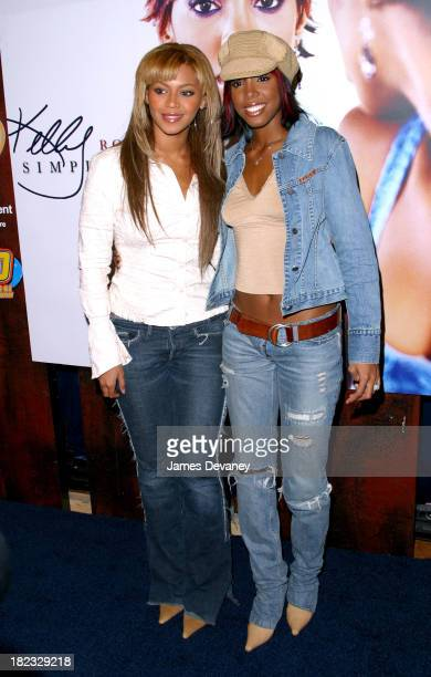 Kelly Rowland and Beyonce Knowles during Kelly Rowland Celebrates Her Debut Album Simply Deep at FYE in New York City New York United States