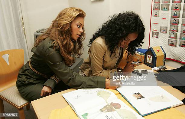 Kelly Rowland and Beyonce Knowles of Destiny's Child sign gifts during the bands visit to the Ronald McDonald House April 13 2005 in Setagaya...